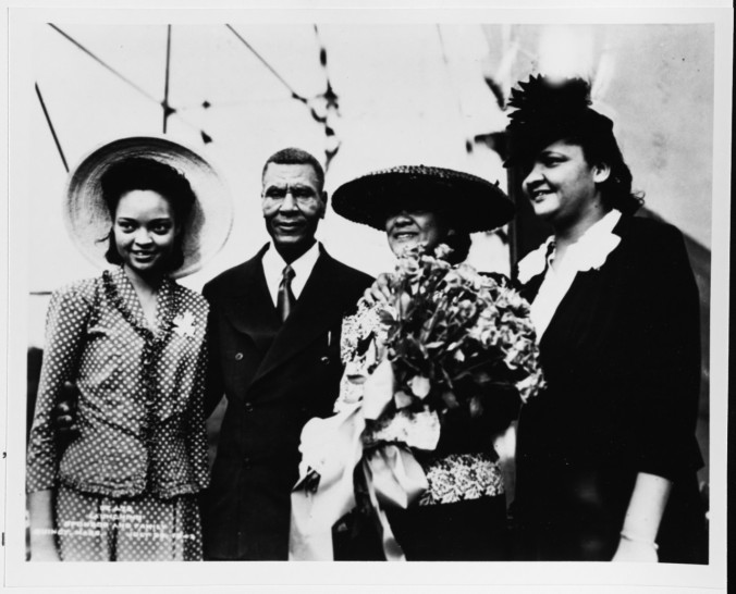 Gathered for the USS Harmon christening on July 25, 1943 are W.D. and Naunita Carroll, middle, and Harmon's sisters Pauline and Constance (via NHHC)